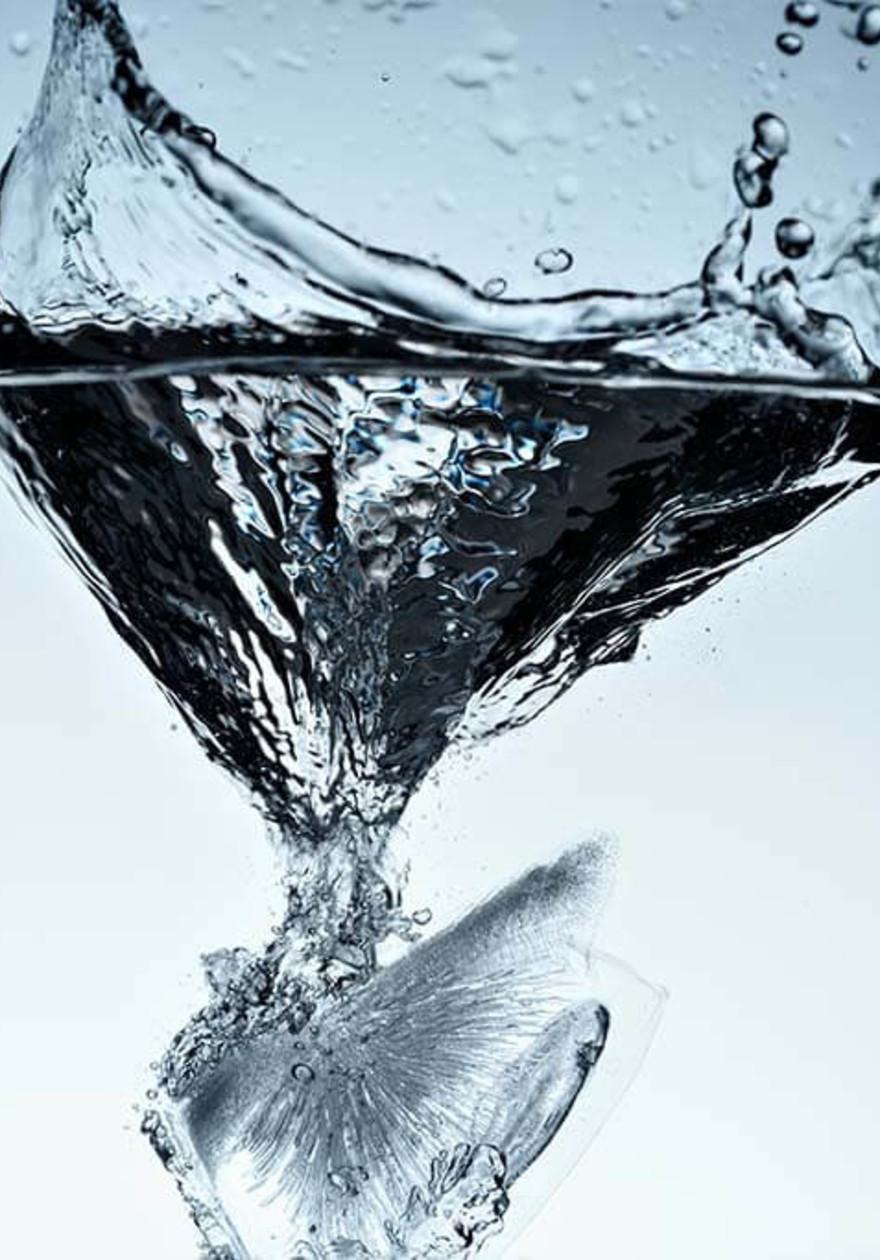 Ice cube splashing water
