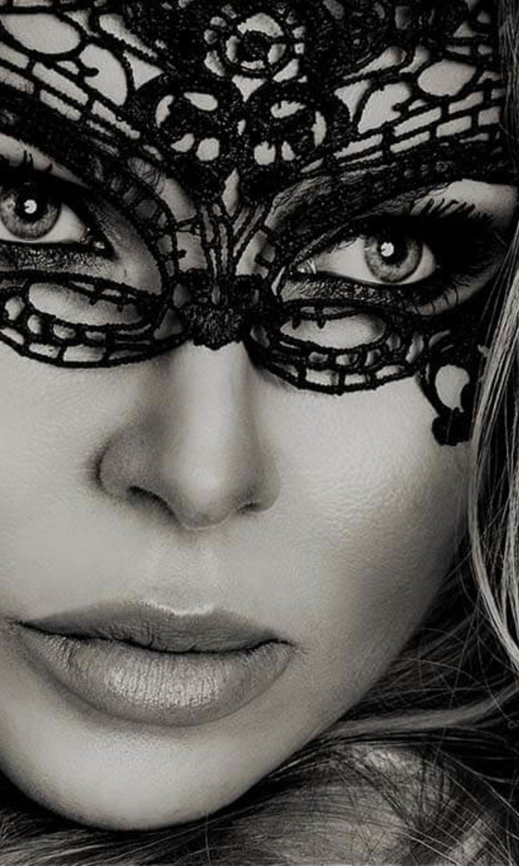 Masked blond woman