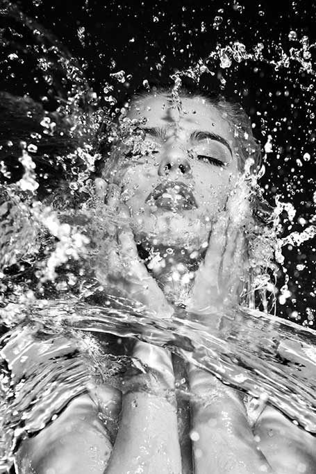 Splashing face black and white