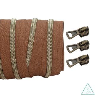 Coil zipper Dark cognac - Shiny Anti-Brass 100cm