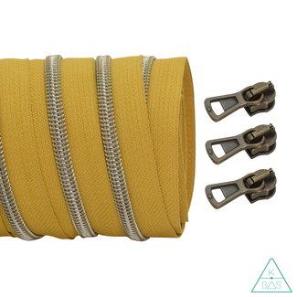 Coil zipper Mustard - Shiny Anti-Brass 100cm