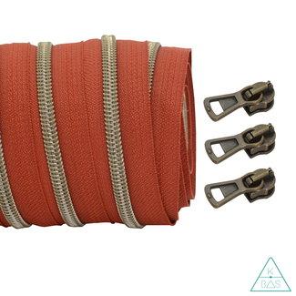 Coil zipper Rust - Shiny Anti-Brass 100cm