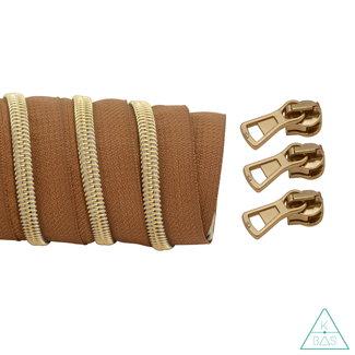 K-Bas Coil zipper Dark cognac - Matt Gold 100cm