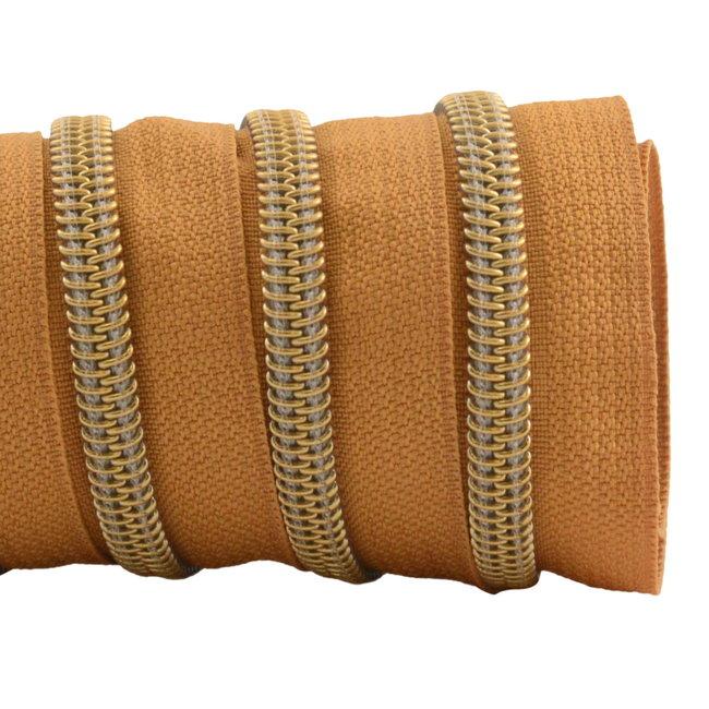 K-Bas Ritstape Spiraal Burned Orange - Mat goud