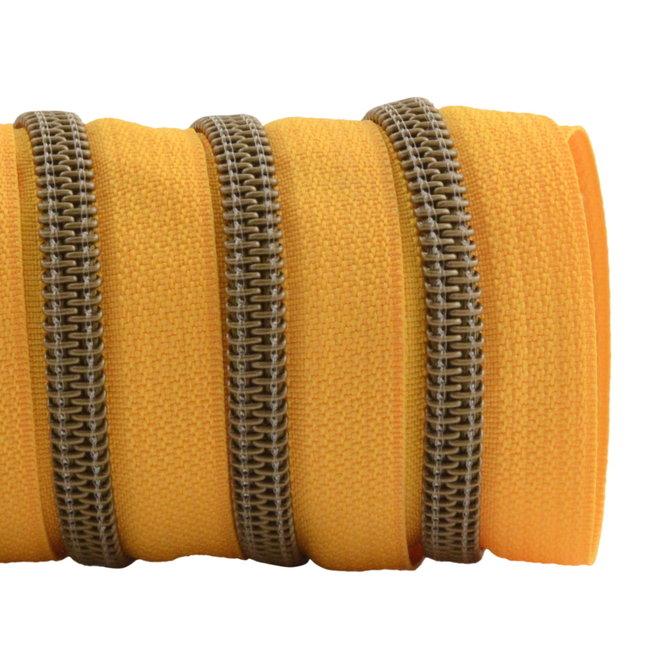 K-Bas Zipper tape Coil Sunny yellow - Matt anti-brass