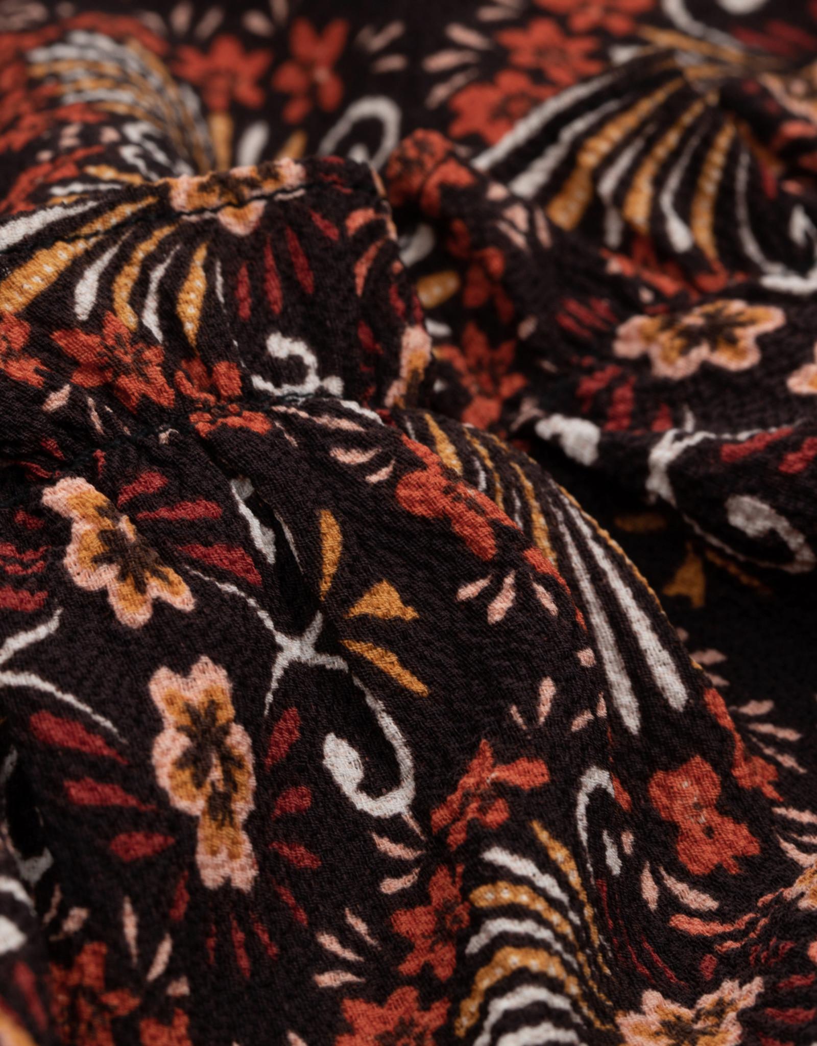 Leuke broek met brede pijpen - tof warm kleur en de print is heel speciaal