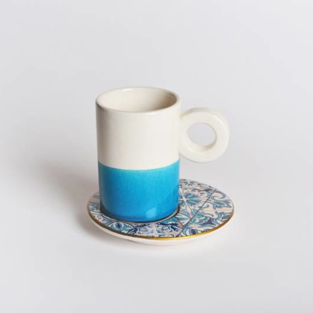 Coffee cup with blue prints