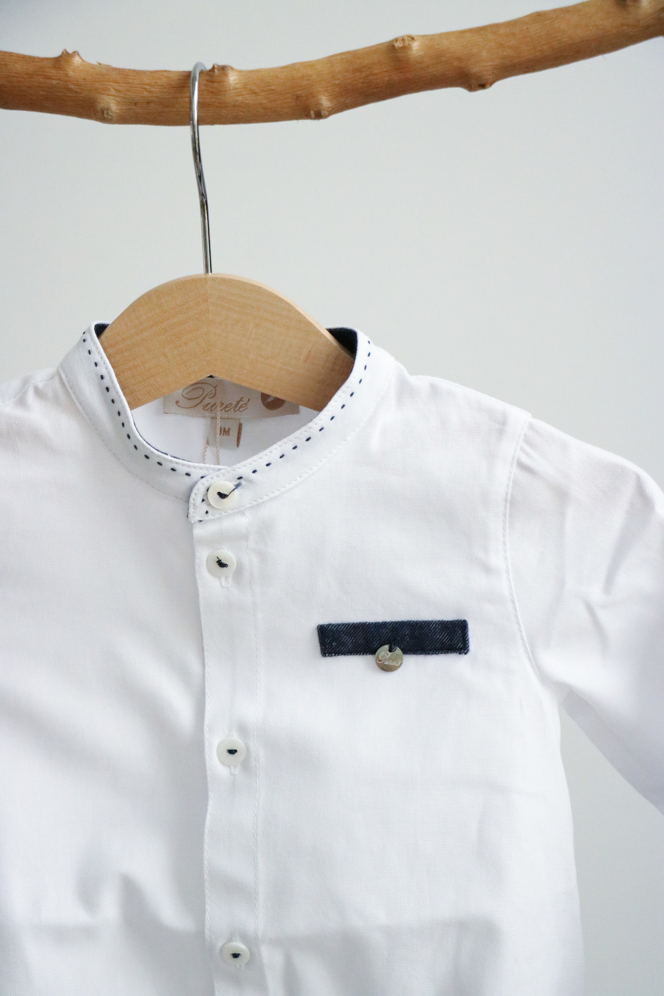 Wit bodyhemdje met jeansblauw detail-2