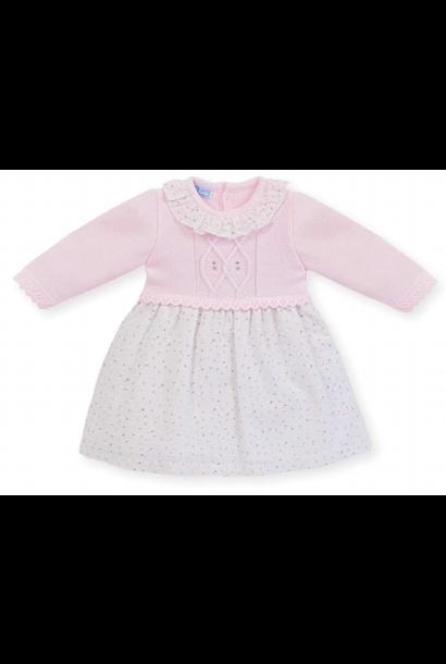 Roze gebreide jurkmet witte rok en  roze details