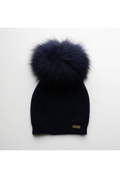 Dark blue hat with faux fur pompon