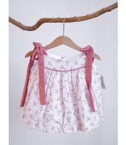 Speels jurkje met roestkleurige strikjes op de schouders