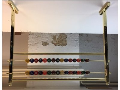 brass ceiling score rack with pool balls