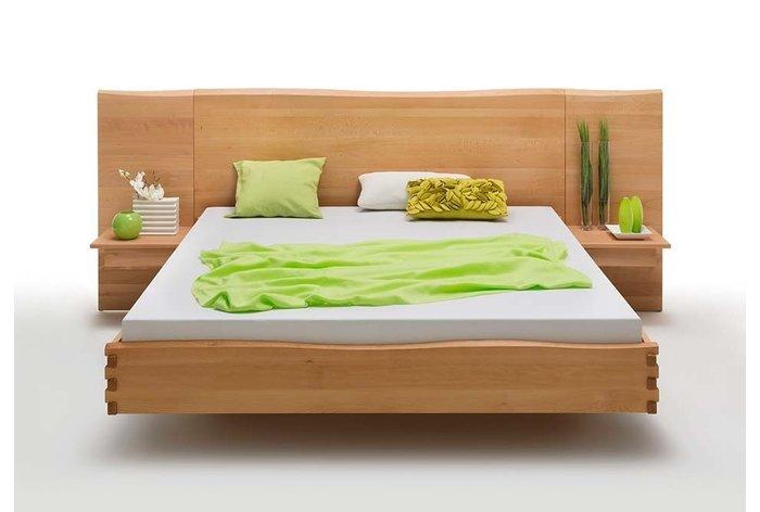 Breed hoofdbord geeft de slaapkamer een uniek en natuurlijk effect