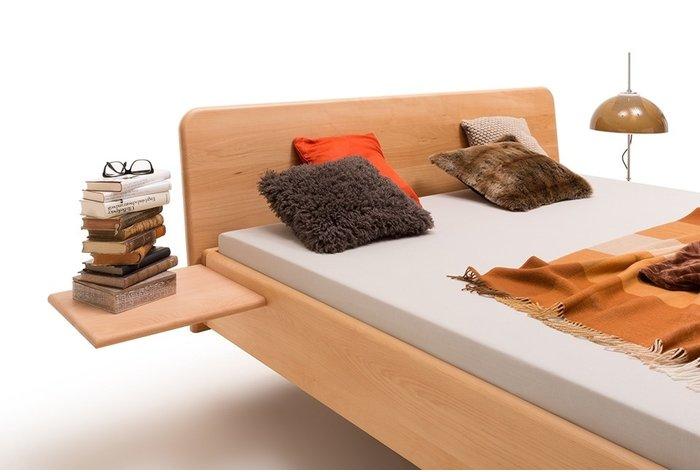 Mooi afgerond hoofdbord geeft het zwevende bed een speels karakter