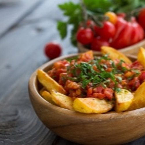 Patatas bravas met peterselie