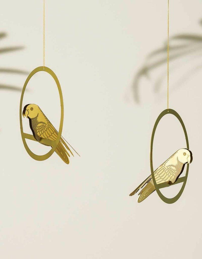 DECORATIE - Schommelende  gouden parkiet