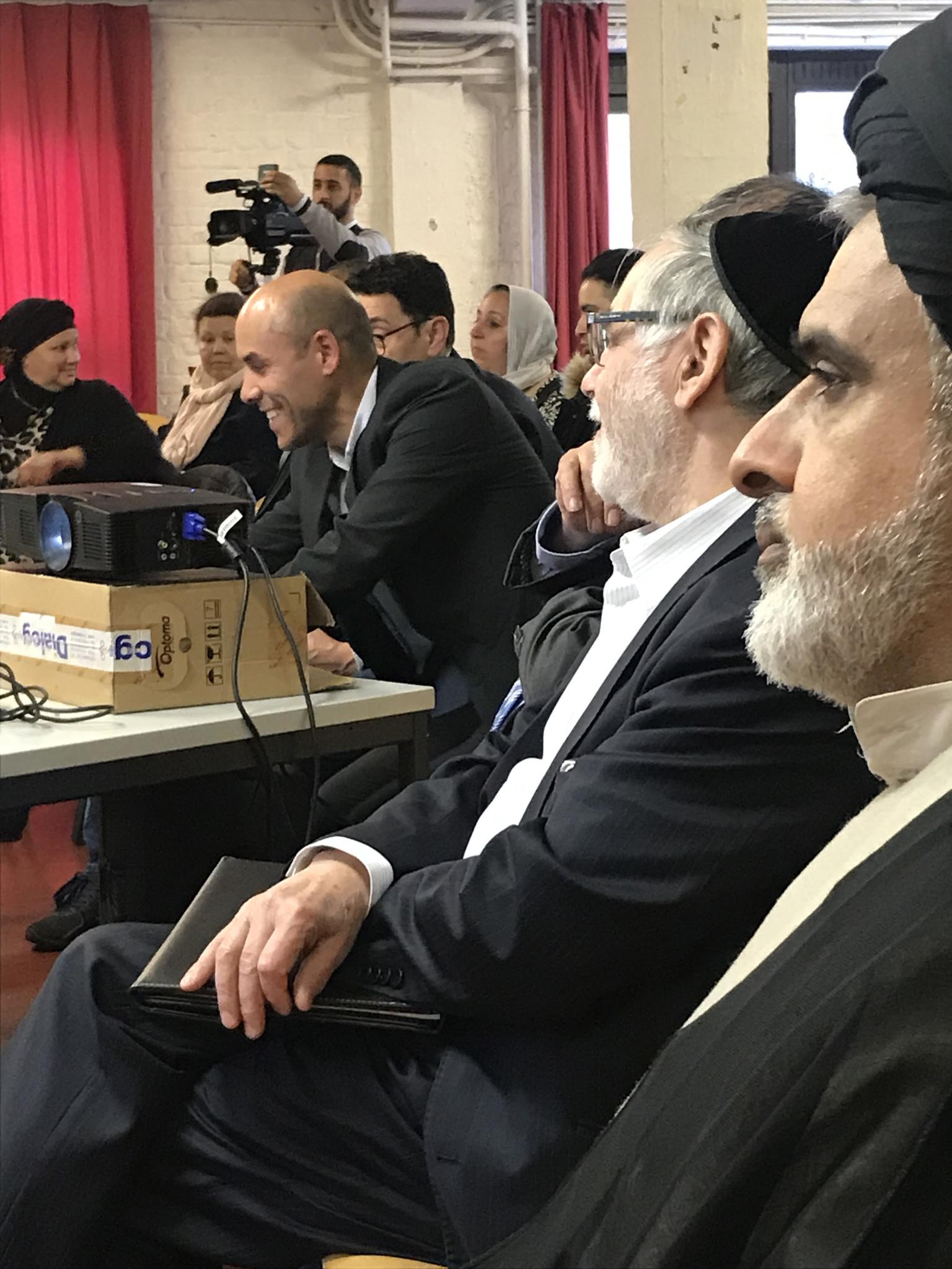 Seyedzyaoddin Salehi sitting among the participants of the debate