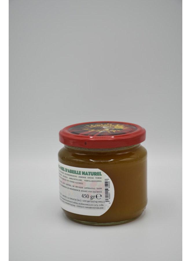 Miel cruda del campo de flores de origen natural