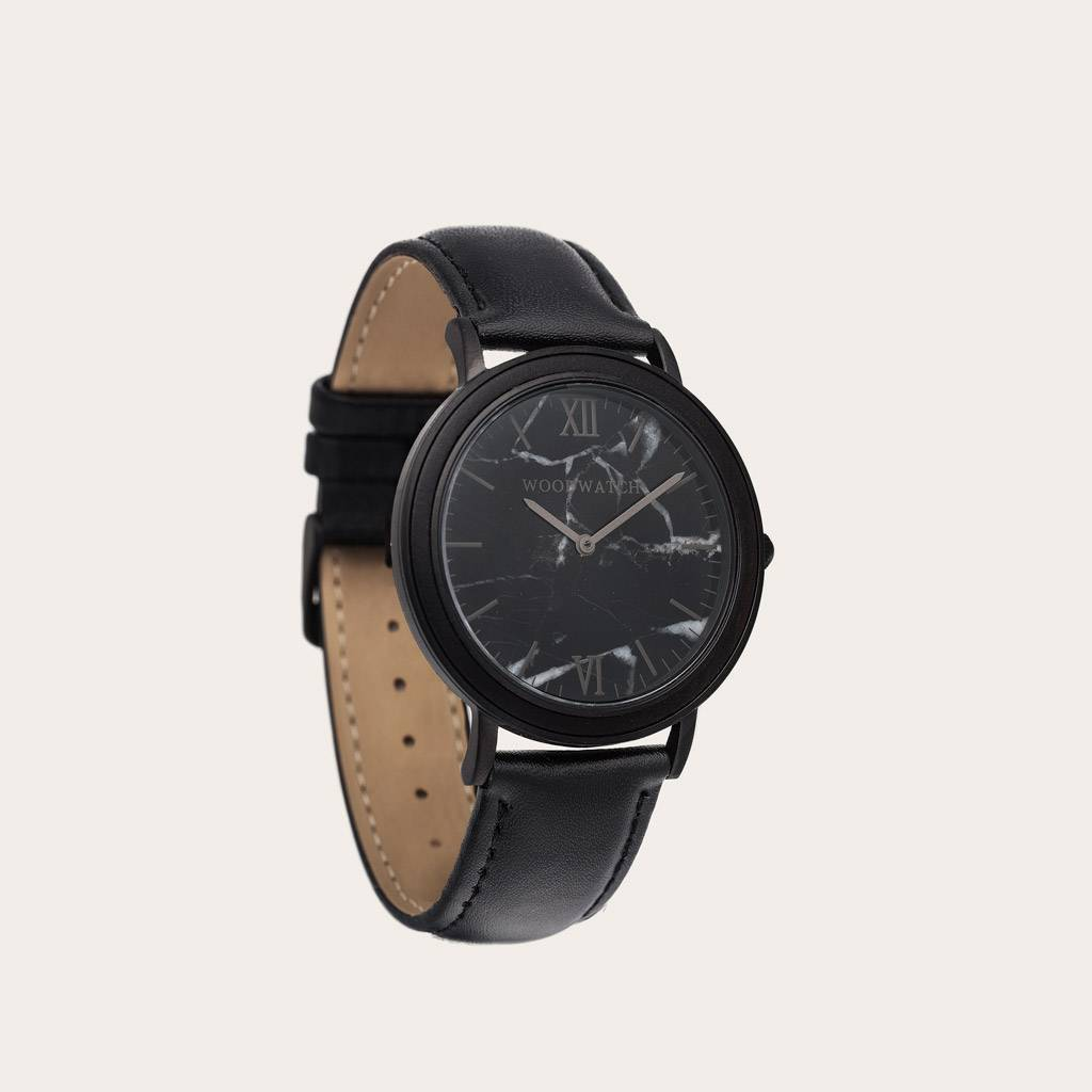 A combination of unique materials with a minimal design to create a timeless look. This modern watch suits both your casual day look and your finest formal wear. A super thin case made of the finest stainless steel with a matte black finish. A statement o