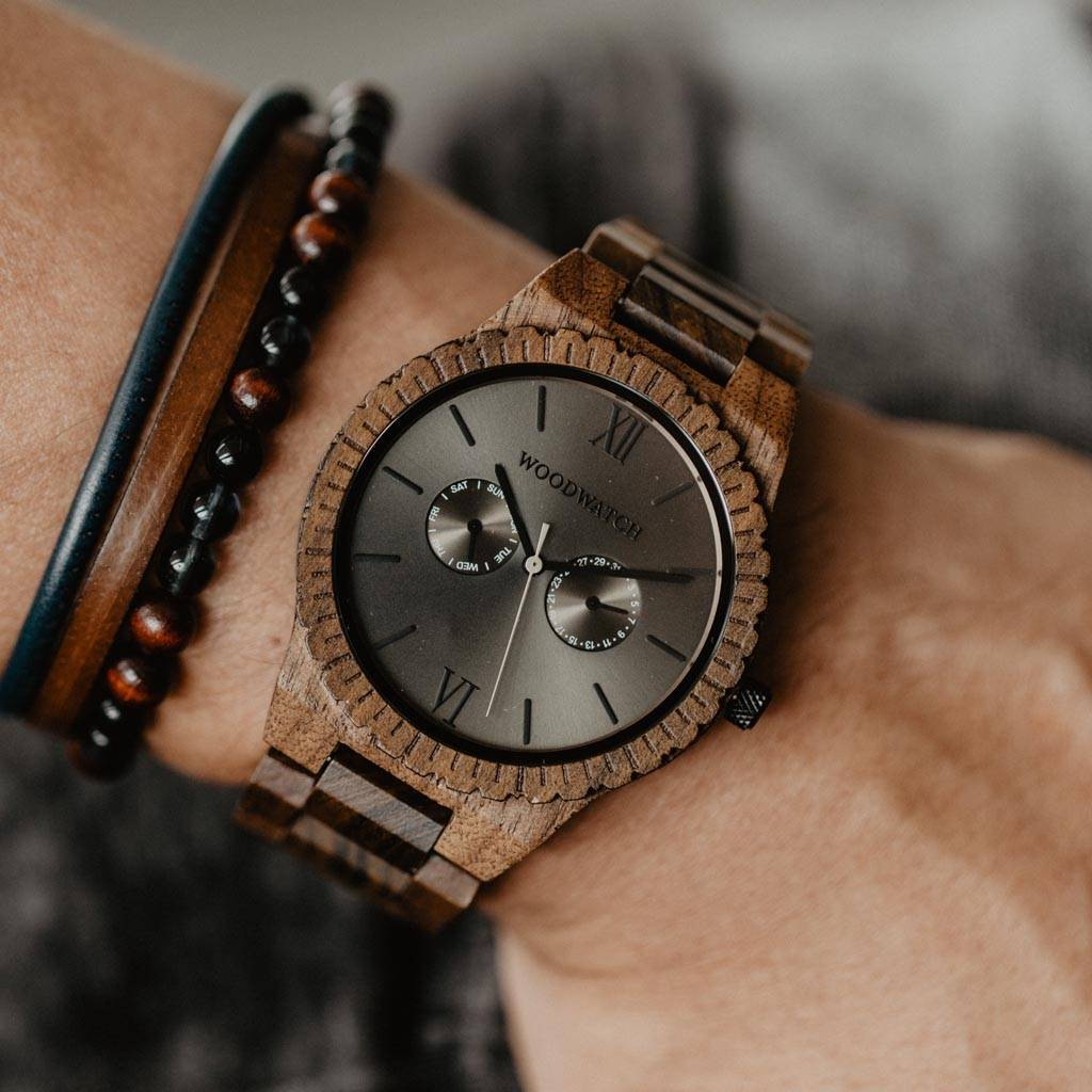 This premium designed watch combines unique new wood types with a luxurious stainless steel dial and backplate. At the heart of the timepiece comes an all new multi-function movement that includes two extra subdials featuring a week and month display. The