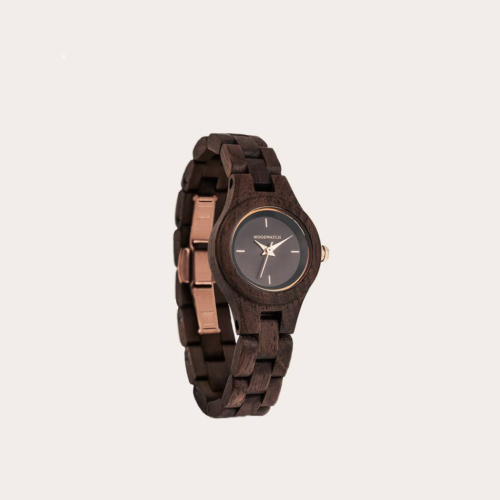 The Viola watch from the FLORA Collection owes its name to be as unique as the sight of a black moon viola flower. Natural walnut wood has been hand-crafted to its finest slenderness. The Viola dial is made of a brushed black stainless-steel that has a sh