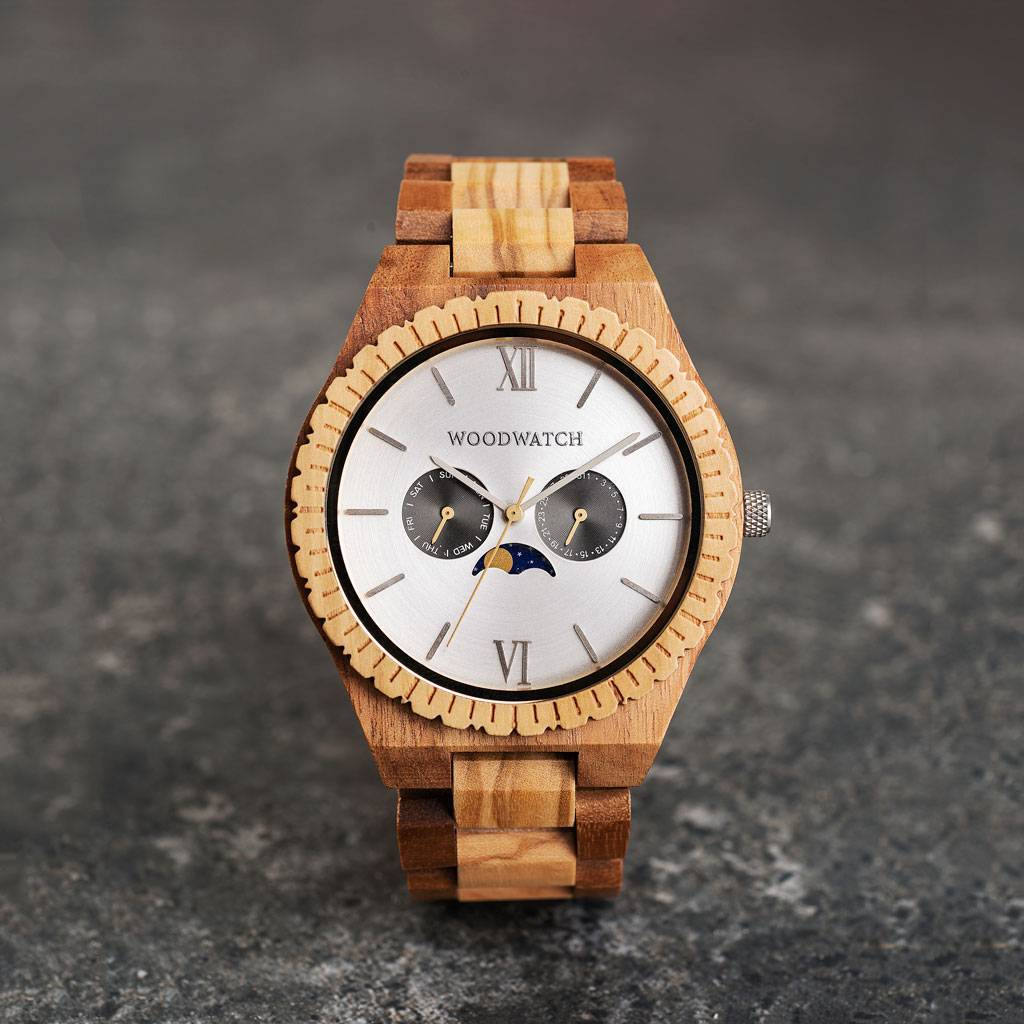 This premium designed watch with moon phase combines unique wood types with a luxurious stainless steel backplate and brushed silver-colored dial. At the heart of the timepiece is a multi-function movement with two subdials featuring a week and month disp