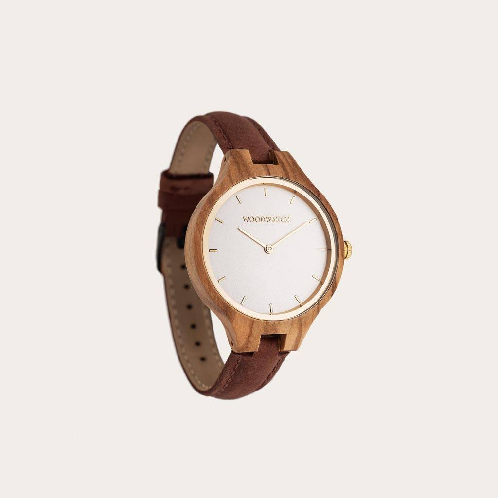 The AURORA Collection breaths the fresh air of Scandinavian nature and the astonishing views of the sky. This light weighing watch is made of European Olive Wood, accompanied by a light stainless-steel dial with a golden highlight and shining golden detai