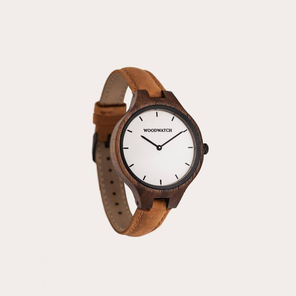The AURORA Collection breaths the fresh air of Scandinavian nature and the astonishing views of the sky. This light weighing watch is made of North American Walnut Wood accompanied by a white stainless-steel dial with black details.The Amber Band is made
