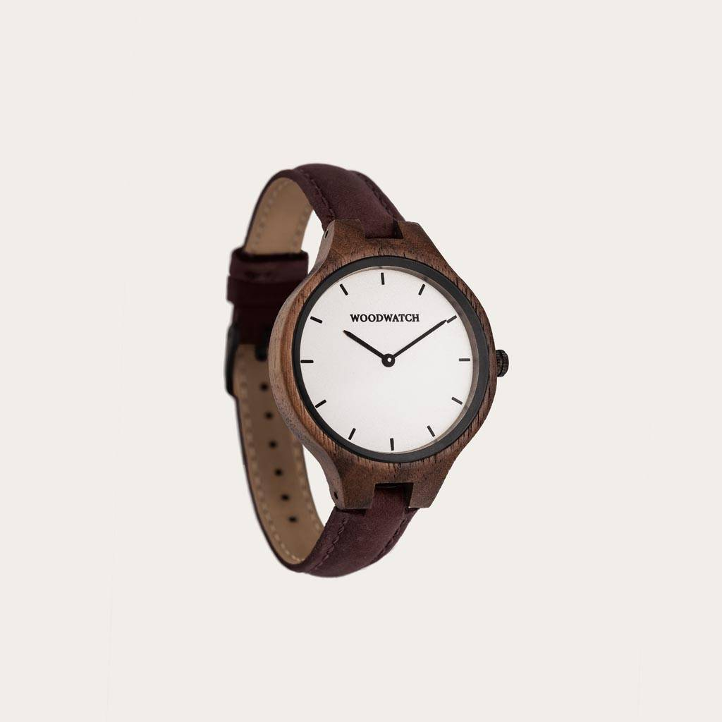 The AURORA Collection breaths the fresh air of Scandinavian nature and the astonishing views of the sky. This light weighing watch is made of North American Walnut Wood accompanied by a white stainless-steel dial with black details. The Hickory Band is ma