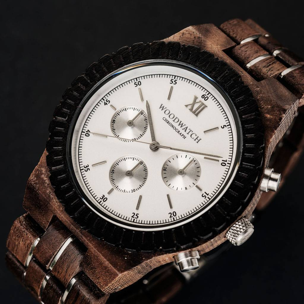 Prepare for adventure with our fully featured, hand-crafted Chronograph wrist watch. This premium design watch features a 45mm walnut case, white stainless steel dial and a SEIKO VD54 movement. The unique new strap combines sustainable walnut wood with hi
