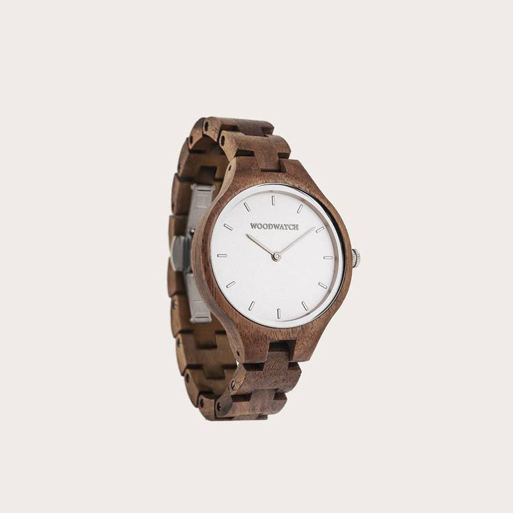 The AURORA Collection breaths the fresh air of Scandinavian nature and the astonishing views of the sky. This light weighing watch is made of Asian Acacia wood, accompanied by a light stainless-steel dial with silver details.<br /> The watch is available with
