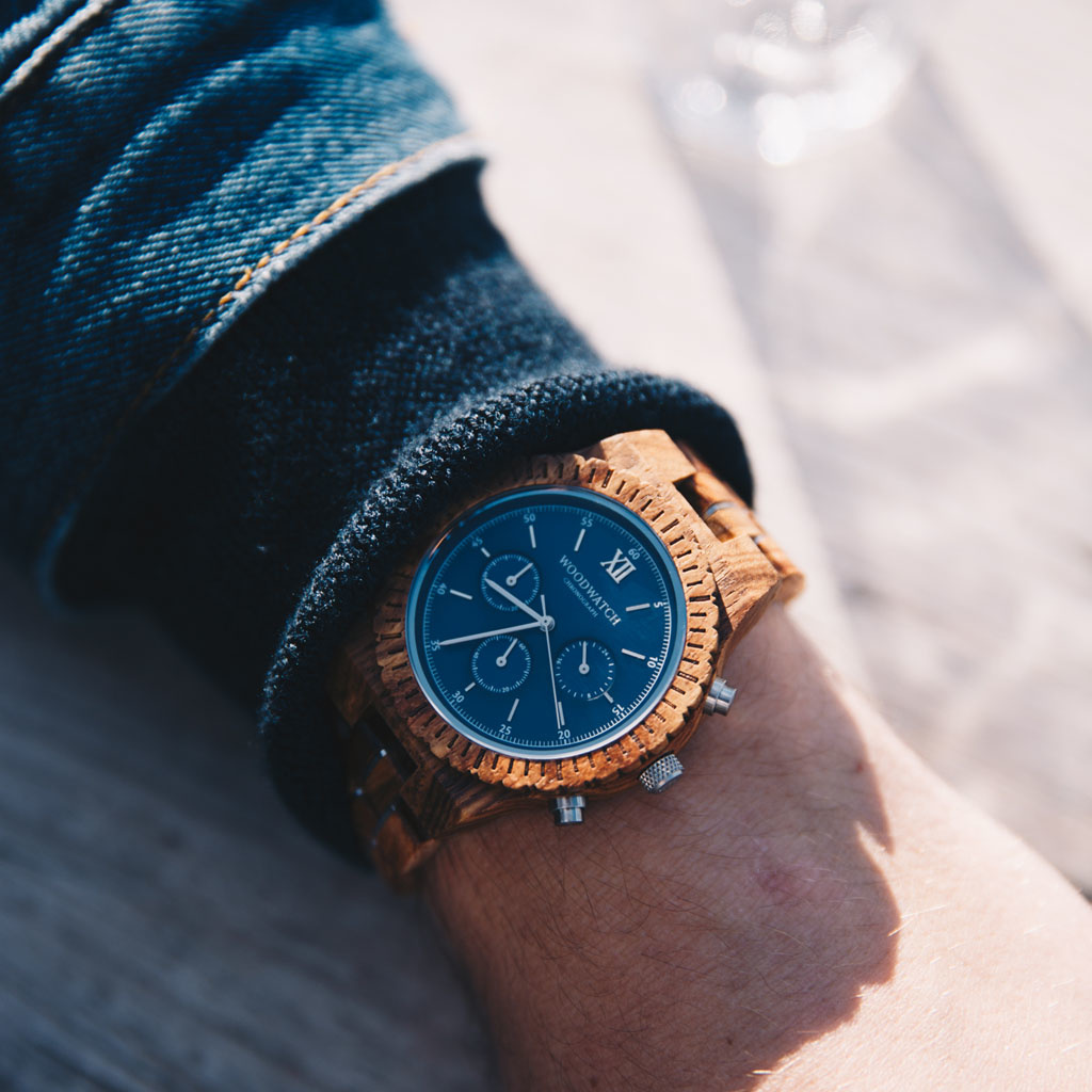 Prepare for adventure with our fully featured, hand-crafted Chronograph wrist watch. This premium design watch features a 45mm kosso wood case, blue stainless steel dial and a SEIKO VD54 movement. The unique new strap combines sustainable kosso wood with