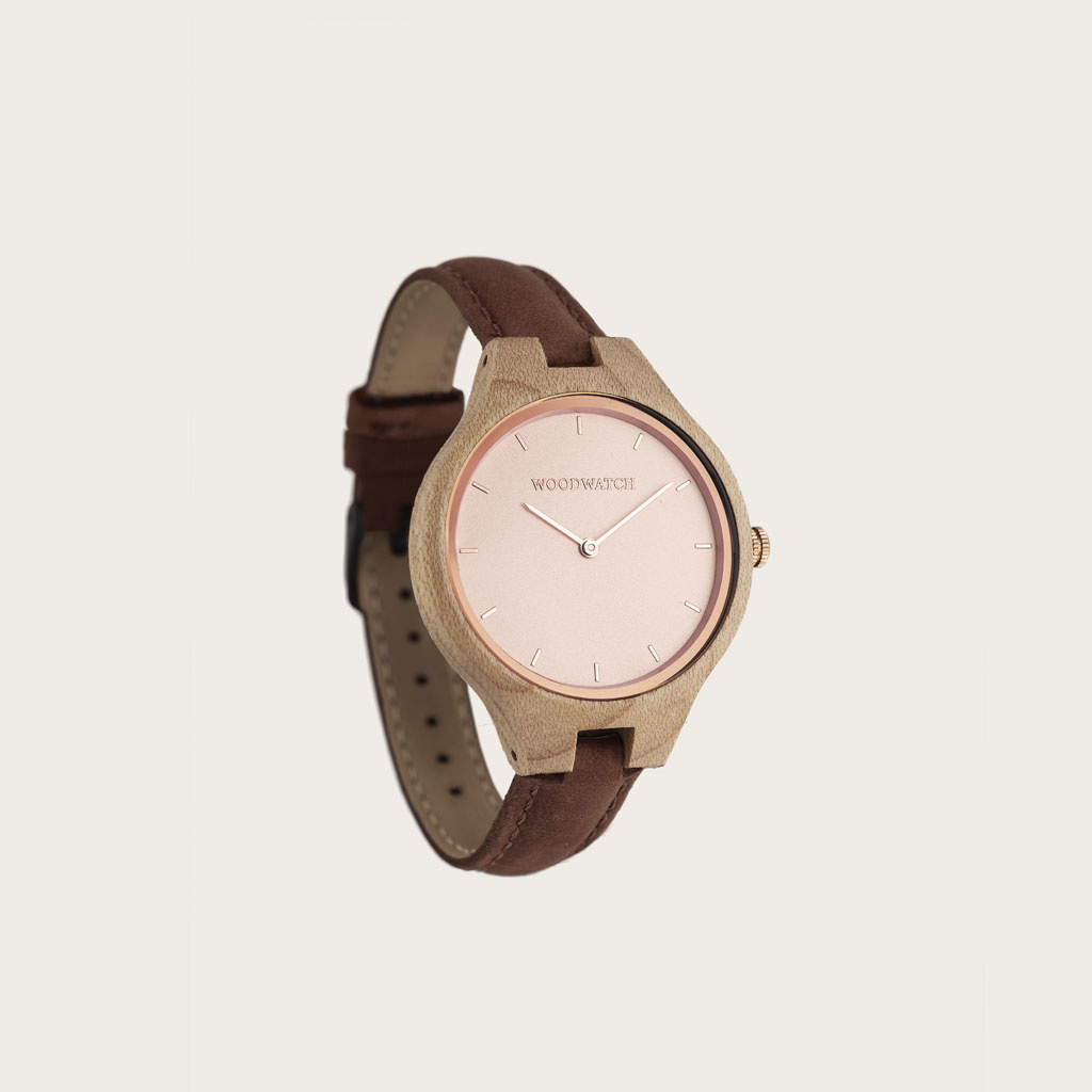 The AURORA Collection breathes the fresh air of Scandinavian nature and the astonishing views of the sky. This light weighing watch is made of Canadian Maplewood, accompanied by a light stainless-steel dial with rosegold details. The watch is available wi