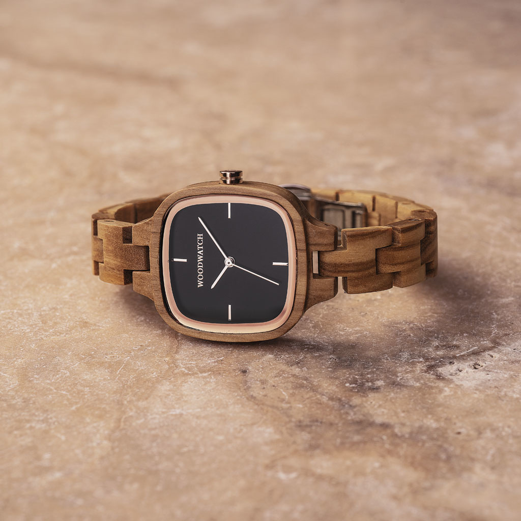 An enduring fashion icon. The CITY Icon features a square case with a black dial and rose gold details. The watch band consists of soft olive wood that has been hand-finished to perfection and to create our latest small-band design.