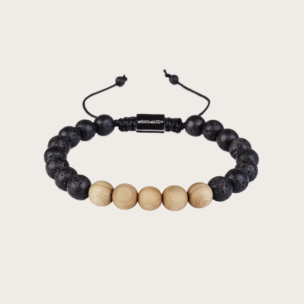 Our handmade Pinewood Volcanic Beads Bracelet features a combination of 8mm Pinewood and Volcanic beads. This bracelet is adjustable and fits most wrist sizes. This bracelet is adjustable and fits most wrist sizes. The perfect accessory to go with any Woo