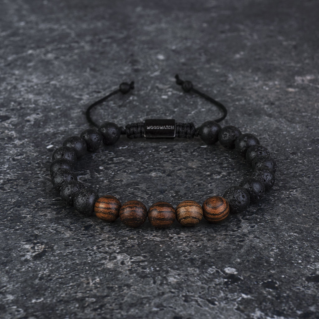 Our handmade Rosewood Volcanic Beads Bracelet features a combination of 8mm Rosewood and Volcanic beads. This bracelet is adjustable and fits most wrist sizes. The perfect accessory to go with any WoodWatch.
