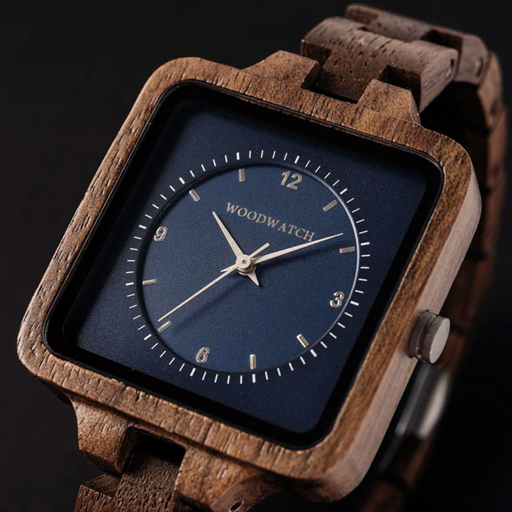 The Sapphire Sky from the SQUARE Collection features an exclusive 36mm square case combined with a blue double layered dual dial. This uniquely designed watch consists of natural Walnut Wood from North America with silver details and is handcrafted to per