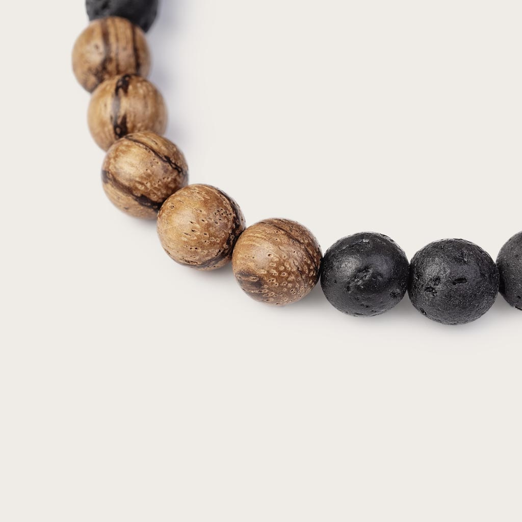 Our handmade Sandalwood Volcanic Beads Bracelet features a combination of 8mm Sandalwood and Volcanic beads. This bracelet is adjustable and fits most wrist sizes.The perfect accessory to go with any WoodWatch.