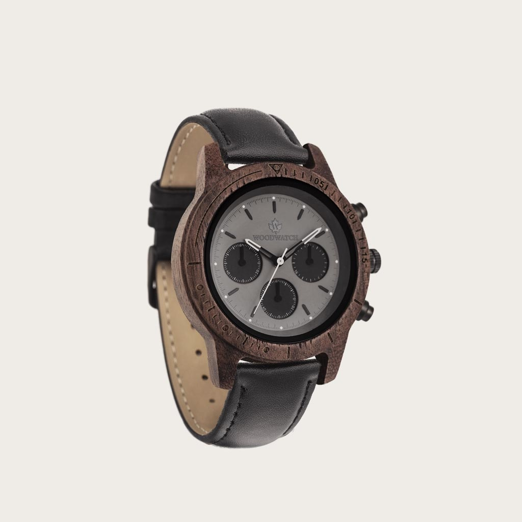Axinite Black Jet features a classic SEIKO VD54 chronograph movement, scratch resistant sapphire coated glass and jet strap. Made from American Walnut Wood and handcrafted to perfection.  The watch is available with a wooden strap or a leather strap.