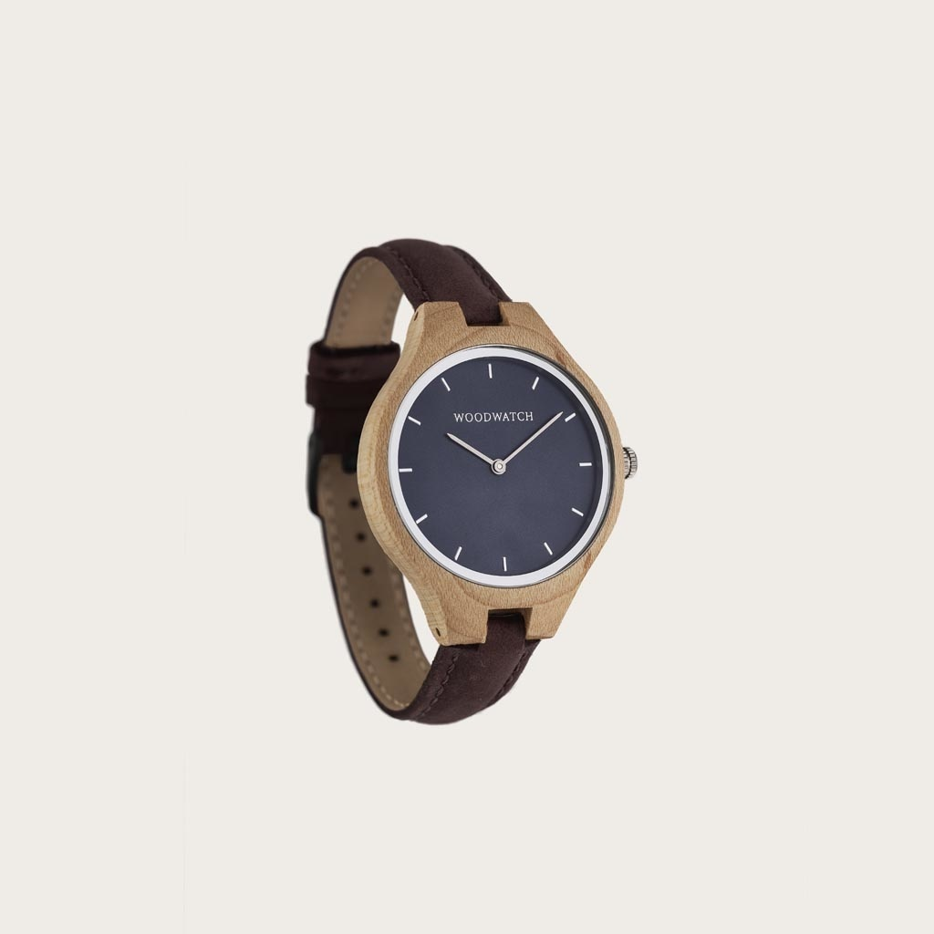 The AURORA Collection breaths the fresh air of Scandinavian nature and the astonishing views of the sky. This light weighing watch is made of Canadian Maplewood, accompanied by a blue stainless-steel dial with silver details.<br /> The watch is available with