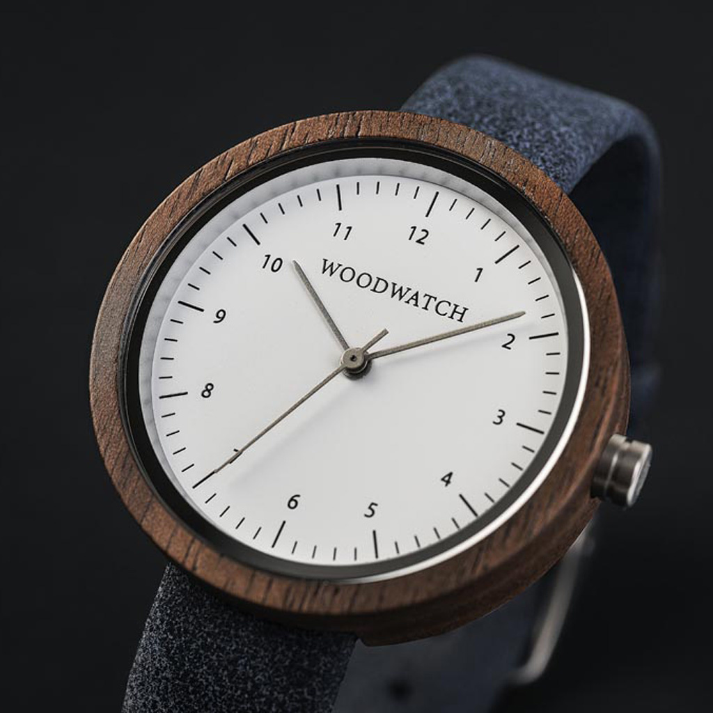 Inspired by contemporary Nordic minimalism. The NORDIC Stockholm features a 36mm diameter walnut case with white dial and silver details. Handmade from sustainably sourced wood combined with an ultra soft navy blue leather strap.