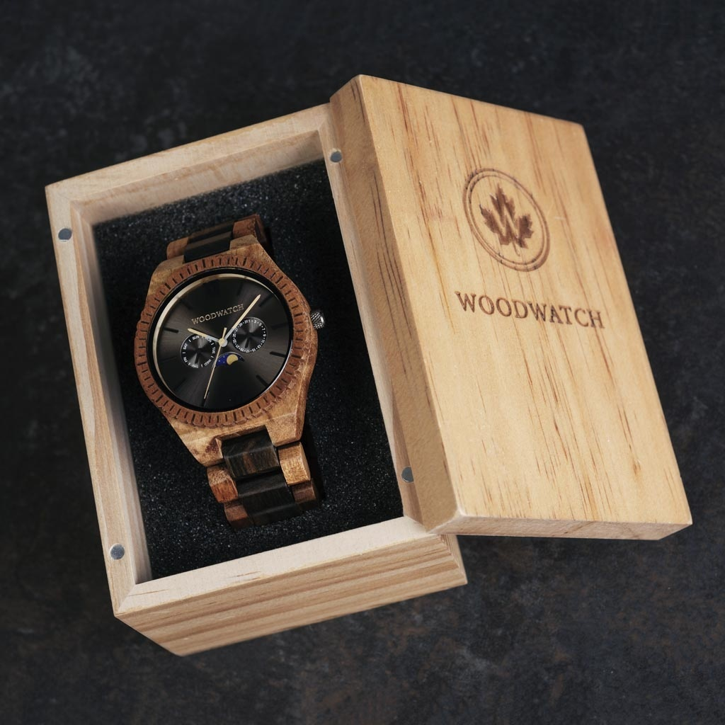 This premium designed watch with moon phase, combines unique new wood types with a luxurious stainless steel dial and backplate. At the heart of the timepiece comes an all new multi-function movement that includes two extra subdials featuring a week and m