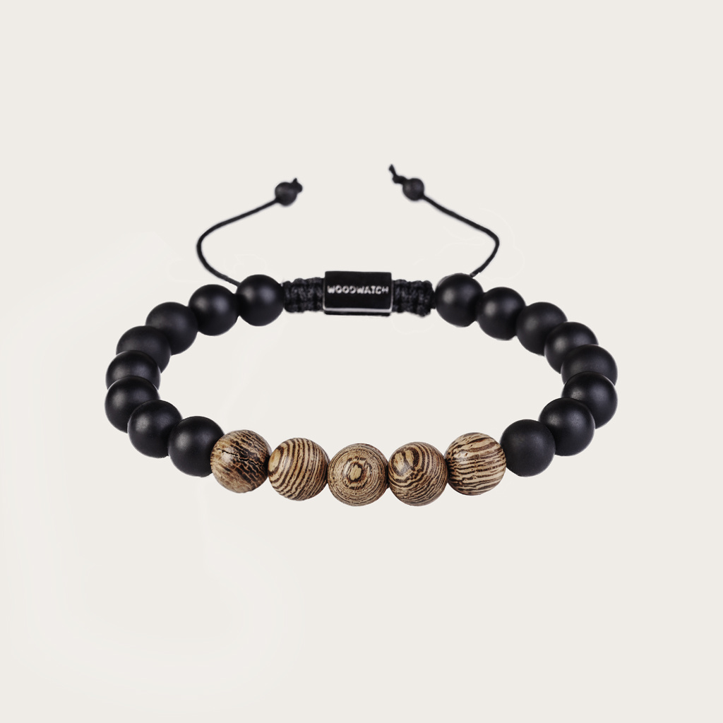 Our handmade Wengewood Agate Beads Bracelet features a combination of 8mm Wengewood and Agate beads. This bracelet is adjustable and fits most wrist sizes. The perfect accessory to go with any WoodWatch.
