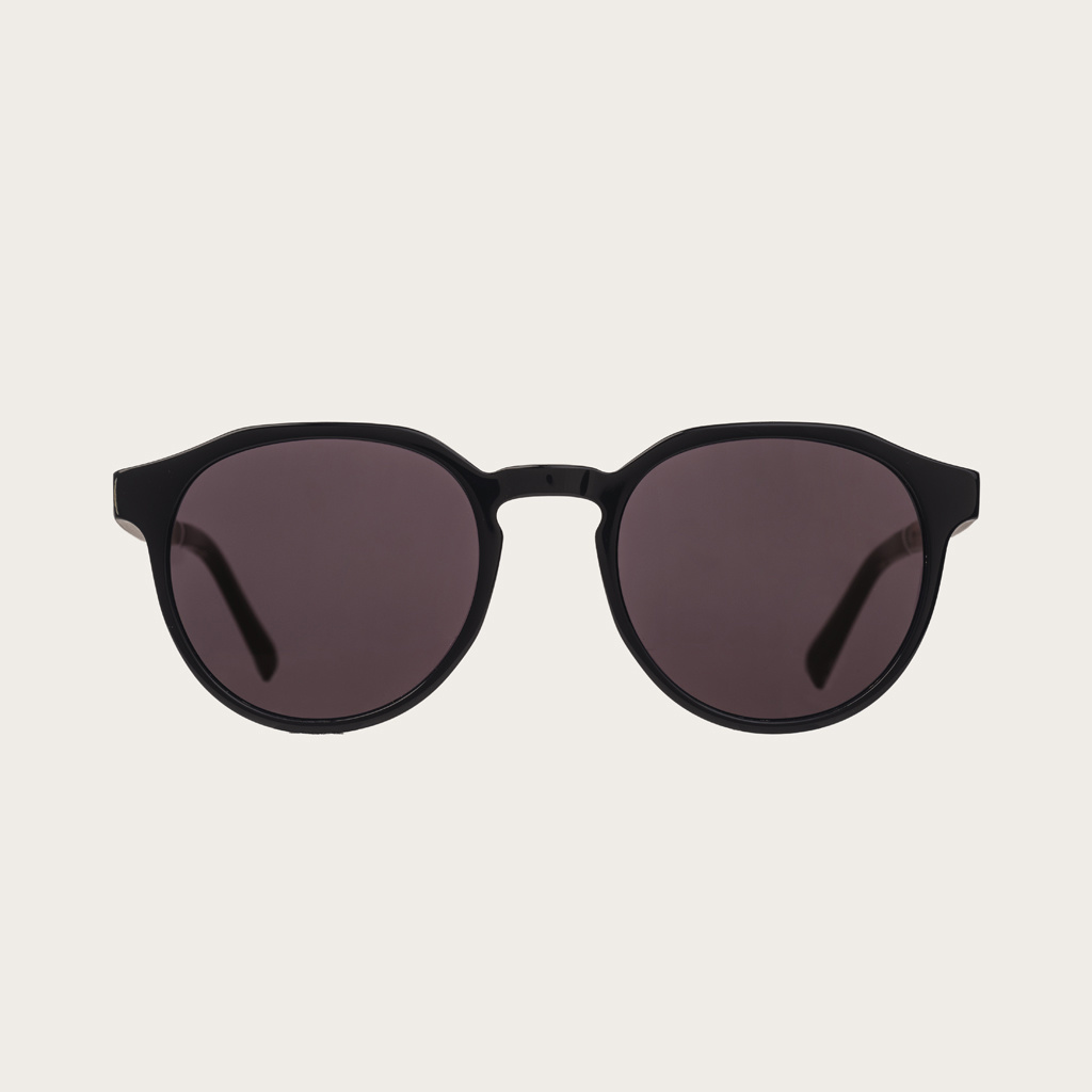 The REVELER All Black features a sleek geometric black frame with black lenses. Composed of durable Italian Mazzucchelli bio-acetate with hand-finished natural rosewood temples and black acetate tips. Bio-acetate is made from cotton and organic resins mak
