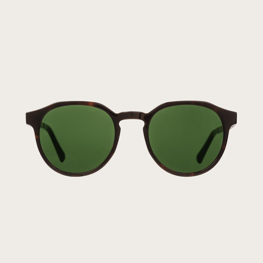 The REVELER Forever Havanas Camo features a sleek geometric dark brown tortoise frame with green camo lenses. Composed of durable Italian Mazzucchelli bio-acetate with hand-finished natural ebony temples and tortoise acetate tips. Bio-acetate is made from