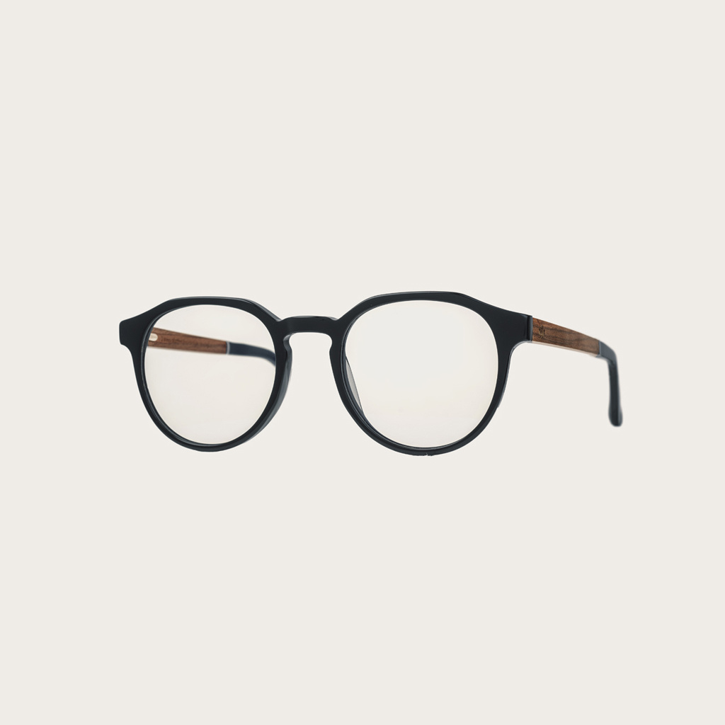"""Filter out harmful excess blue light which can cause eye strain, headaches and poor sleep. The Reveler """"Black"""" features a sleek geometric black frame and is composed of durable Italian Mazzucchelli bio-acetate with hand-finished natural rosewood temples a"""