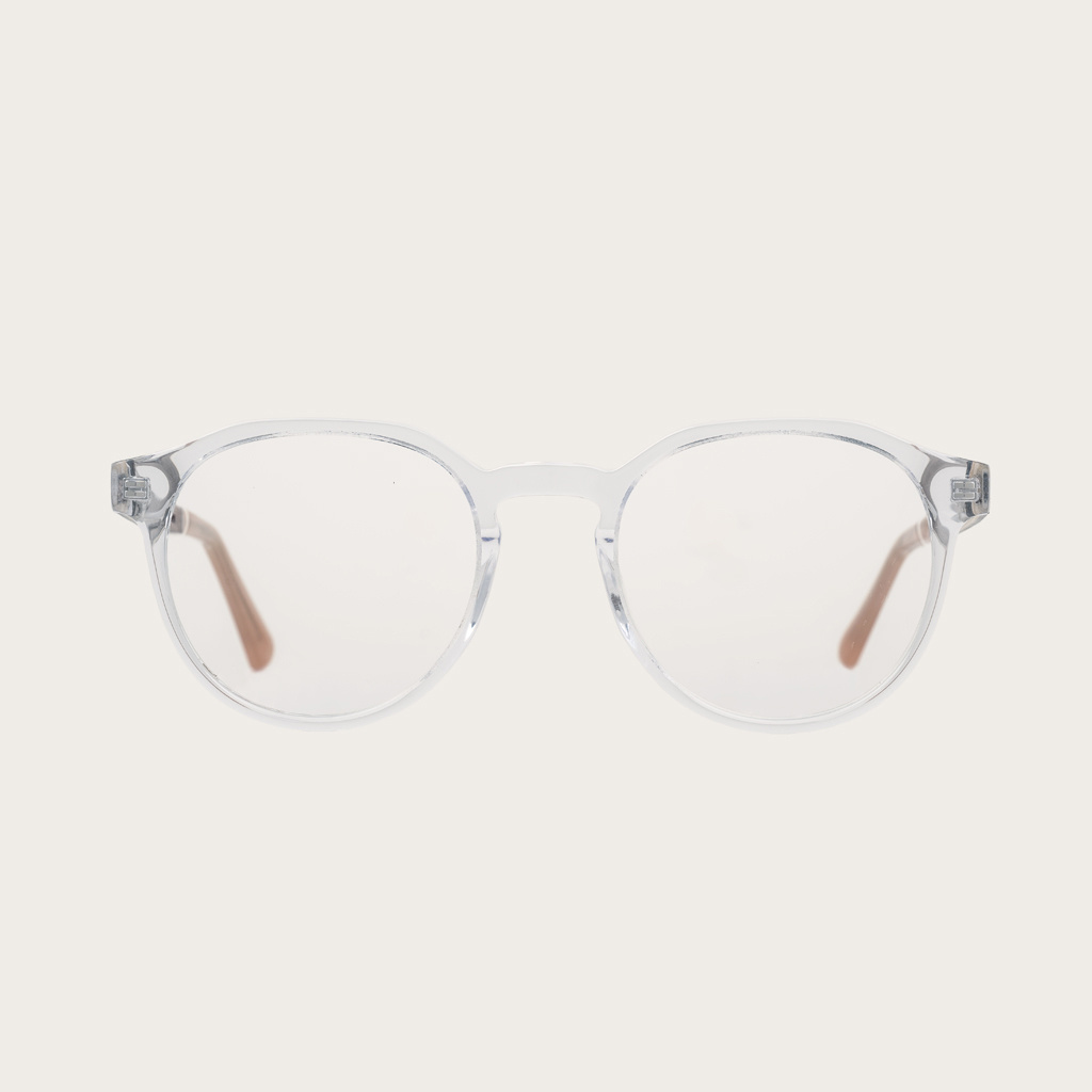 """Filter out harmful excess blue light which can cause eye strain, headaches and poor sleep. The Reveler """"Clear"""" features a sleek geometric clear frame and is composed of durable Italian Mazzucchelli bio-acetate with hand-finished natural senna siamea wood"""