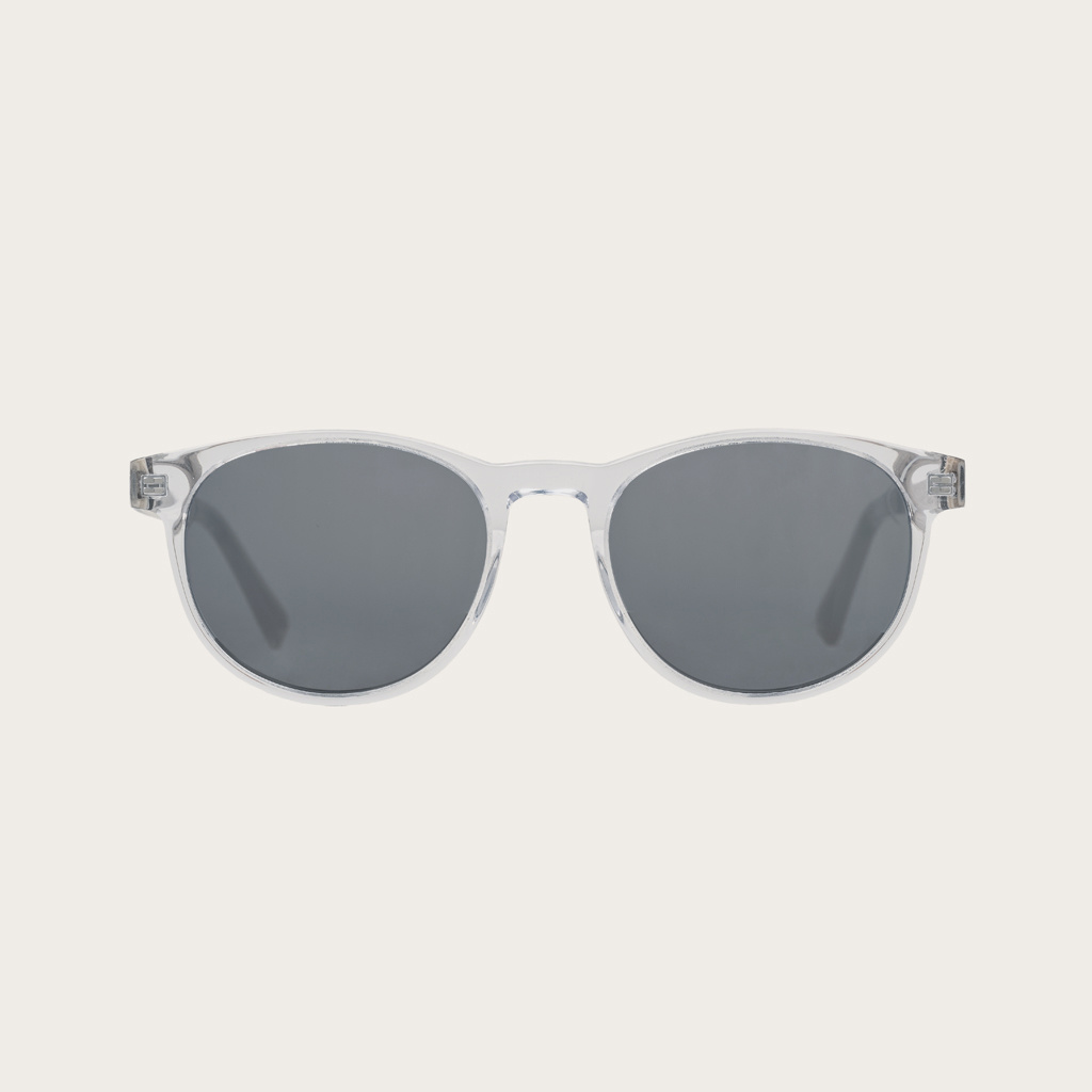 The ELLIPSE Clear Smoke features a characteristic rounded clear frame with grey smoke lenses Composed of durable Italian Mazzucchelli bio-acetate with hand-finished natural senna siamea wood temples and nude acetate tips. Bio-acetate is made from cotton a
