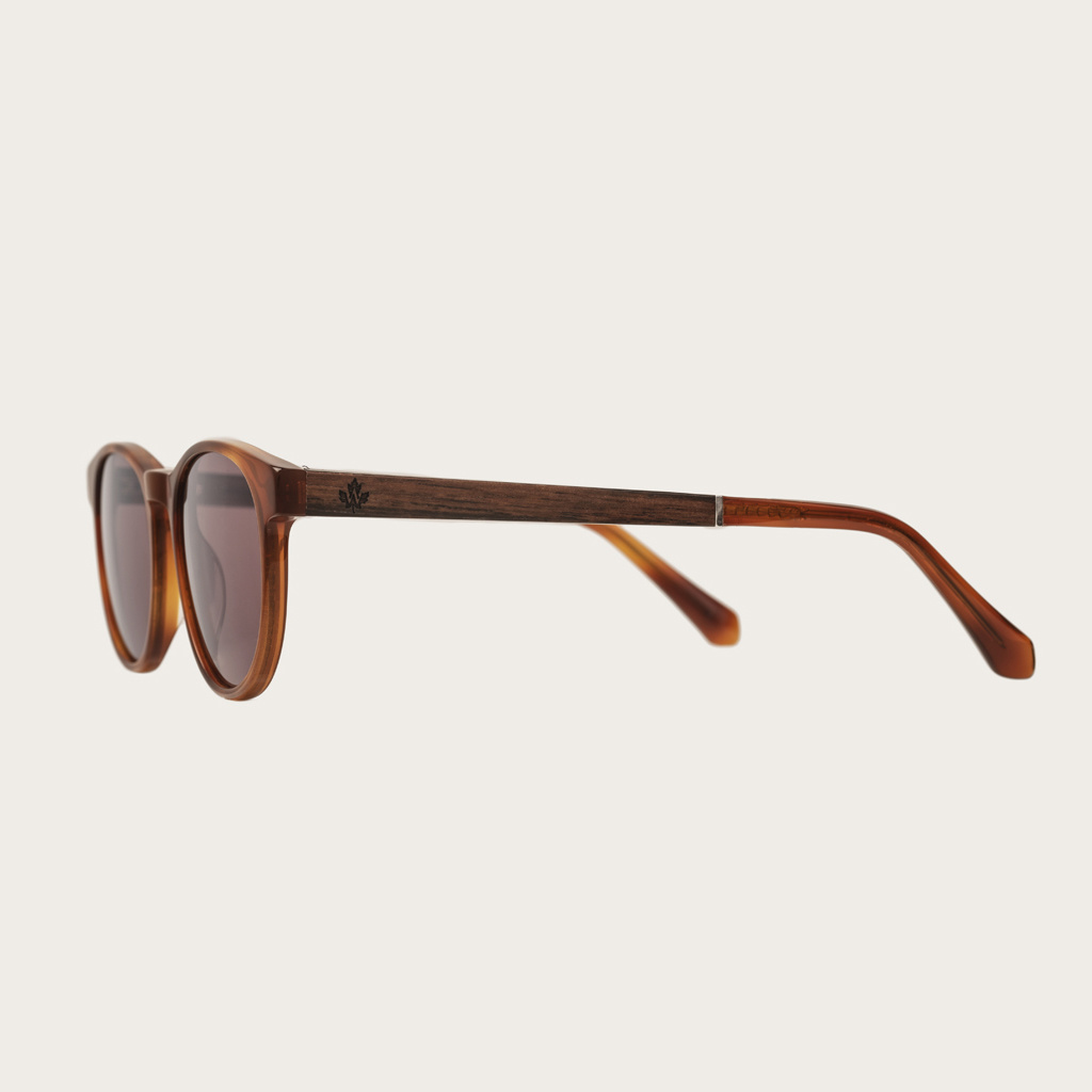 The ELLIPSE Classic Havanas Brown features a characteristic rounded dark yellow tortoise frame with mocha brown lenses. Composed of durable Italian Mazzucchelli bio-acetate with hand-finished natural ebony temples and tortoise acetate tips. Bio-acetate is