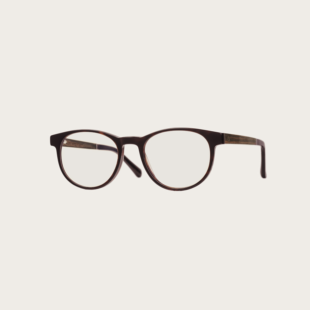 """Clear specs fitted with our BlueBlock lenses. Filter out harmful excess blue light which can cause eye strain, headaches and poor sleep. The Ellipse """"Forever Havanas"""" features a characteristic rounded dark brown tortoise frame and is composed of durable I"""